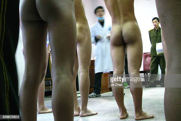 Chinese youth receive a medical examination for the People's Liberation Army in Suining Sichuan province November 8 2009 VCP