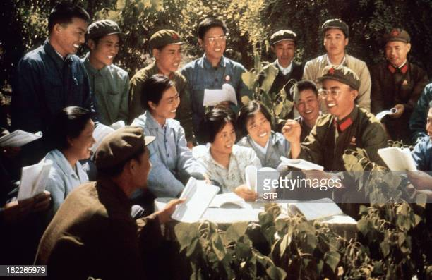 Chinese youth study with red guards the copies of Mao Zedong Little Red Book somewhere in China in a picture released in 1971 by official Chinese...