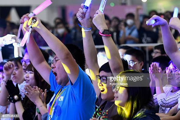 Chinese youths cheer at a live performance during an anime event organized by the Japanese Embassy in Beijing on Oct 2 2016 In a bid to boost...