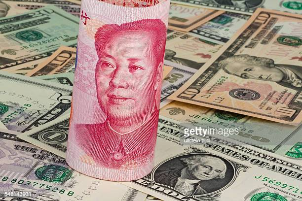 Chinese Yuan Renminbi with portrait of Mao Zedong and Dollar banknotes with portrait of George Washington
