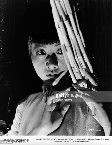 ChineseAmerican actress Anna May Wong stage name of Wong Liu Tsong in a scene from the film 'Island Of Lost Men' directed by Kurt Neumann for...