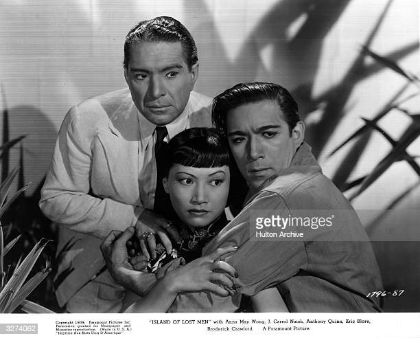 ChineseAmerican actress Anna May Wong stars with J Carrol Naish and Anthony Quinn in the film 'Island Of Lost Men' directed by Kurt Neumann for...