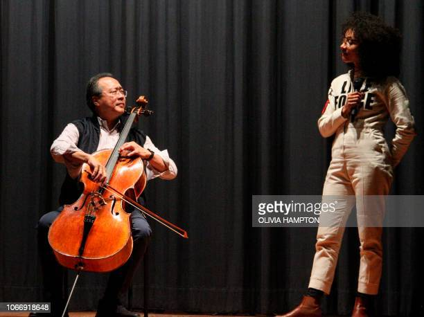 ChineseAmerican cellist YoYo Ma performs with musician Esperanza Spalding at Anacostia High School in Washington on November 30 2018 Ma's Bach...
