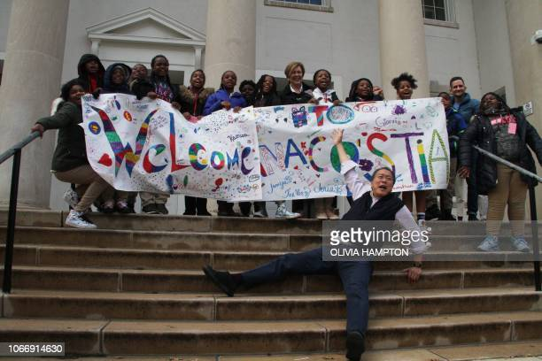 ChineseAmerican cellist YoYo Ma poses with students at Anacostia High School in Washington on November 30 2018 Ma's Bach Project is bringing the...