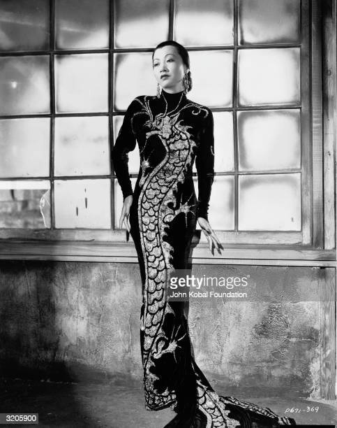 ChineseAmerican film star Anna May Wong wearing a dress with dragon motif in a publicity shot for 'Limehouse Blues' directed by Alexander Hall