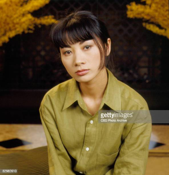 Chineseborn American actress Bai Ling sits and wears a man's green shirt on an episode of the CBS drama 'Touched by an Angel' entitled 'The Spirit of...