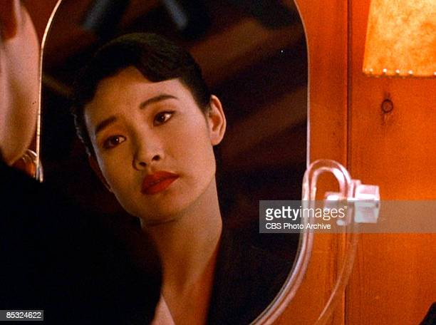 Chineseborn American actress Joan Chen looks in the mirror in a scene from the pilot episode of the television series 'Twin Peaks' originally...