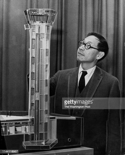 Chineseborn architect IM Pei is seen on December 17 with a model of an airport control tower he designed