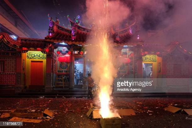 ChineseIndonesian ignite fireworks during during 6th days Chinese New Year celebrations or known as Cue Lak in Selatpanjang Meranti Island Regency...