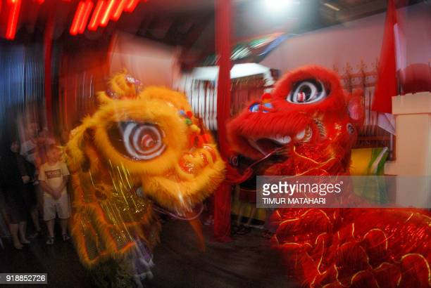 ChineseIndonesians perform a lion dance at a Chinese temple to mark the Lunar New Year in Bandung West Java province on February 16 2018 The 2018...