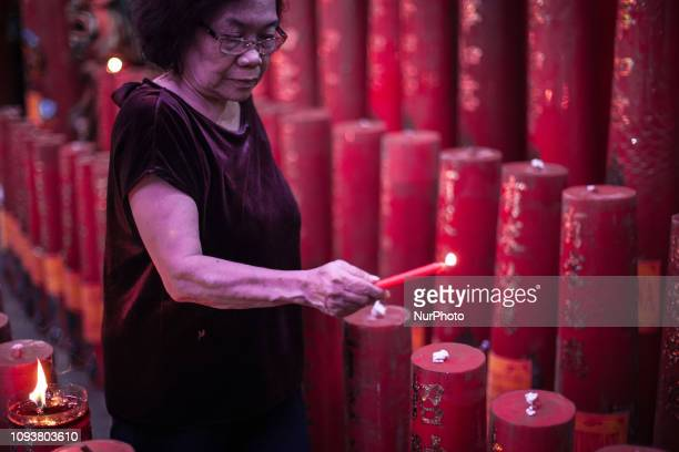 ChineseIndonesians pray at a Chinese temple to mark the Lunar New Year in Jakarta on Monday midnight February 4 2019 The 2019 Lunar New Year fell on...