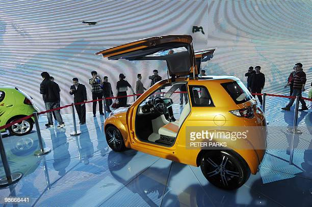 A Chinese Made Geely Electric Car Is On Display At The Beijing Auto