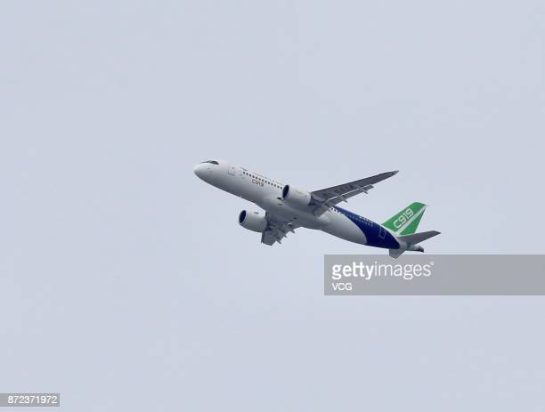 Chineseproduced passenger jet C919 takes off from Shanghai Pudong International Airport on November 10 2017 in Shanghai China The passenger jet will...