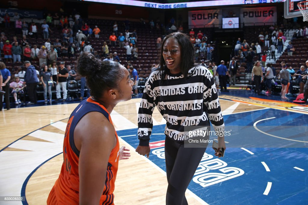 Chiney Ogwumike and Alex Bentley #20 of the Connecticut Sun celebrate a win against the Dallas Wings on August 12, 2017 at Mohegan Sun Arena in Uncasville, CT.