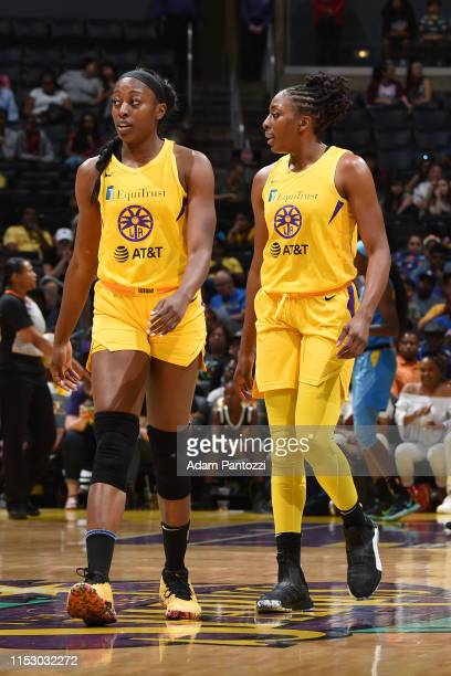 Chiney Ogwumike and Nneka Ogwumike of the Los Angeles Sparks looks on during the game against the Chicago Sky on June 30 2019 at the Staples Center...