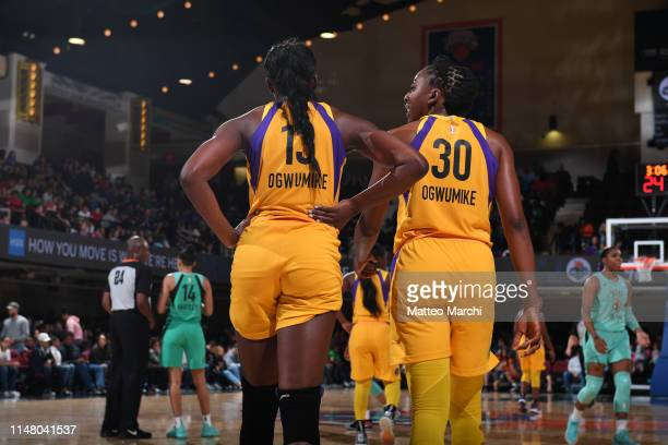 Chiney Ogwumike and Nneka Ogwumike of the Los Angeles Sparks talk during a game against the New York Libertyon June 4 2019 at the Westchester County...