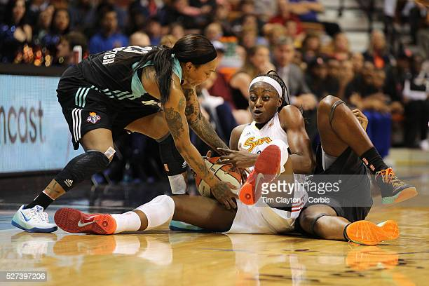 Chiney Ogwumike Connecticut Sun the WNBA number one draft pick making her WNBA debut challenges for a loose ball with Tina Charles New York Liberty...
