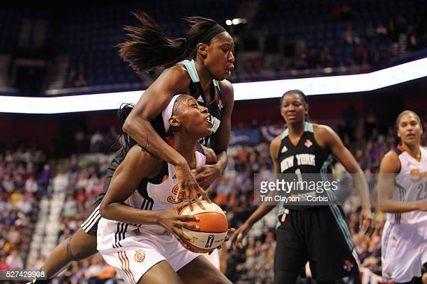 Chiney Ogwumike Connecticut Sun the WNBA number one draft pick making her WNBA debut pump fakes and draws the foul as she is hit hard by Tina Charles...