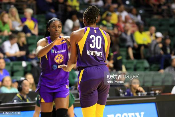 Chiney Ogwumike of Los Angeles Sparks and Nneka Ogwumike of the Los Angeles Sparks highfive during a game against the Seattle Storm on June 21 2019...