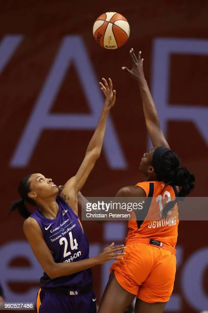 Chiney Ogwumike of the Connecticut Sun attempts a shot over DeWanna Bonner of the Phoenix Mercury during the first half of WNBA game at Talking Stick...