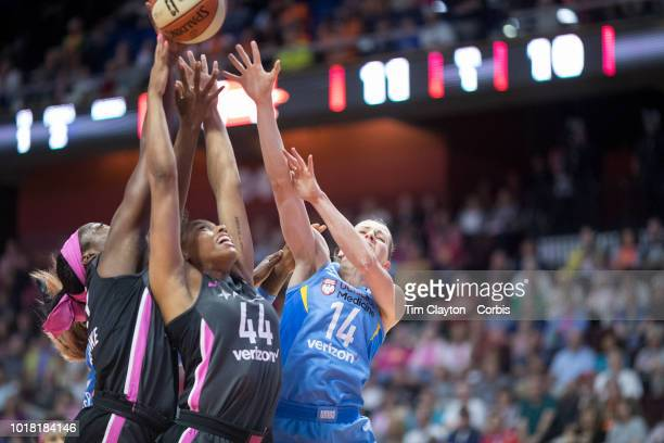 Chiney Ogwumike of the Connecticut Sun Betnijah Laney of the Connecticut Sun and Allie Quigley of the Chicago Sky challenge for a rebound during the...