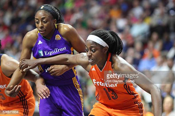 Chiney Ogwumike of the Connecticut Sun defends against her sister Nneka Ogwumike of the Los Angeles Sparks at a free throw during the Los Angeles...