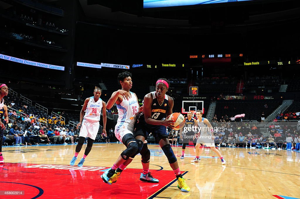 Chiney Ogwumike #13 of the Connecticut Sun drives to the basket against Angel McCoughtry #35 of the Atlanta Dream on July 29, 2014 at Philips Arena in Atlanta, Georgia.