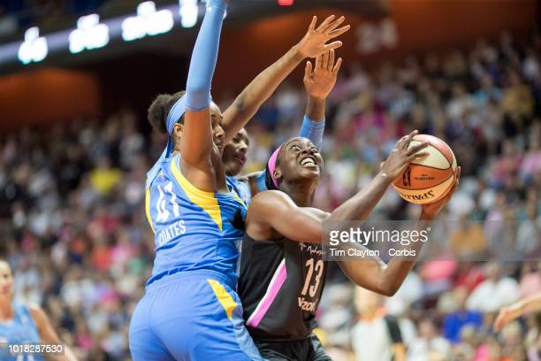 Chiney Ogwumike of the Connecticut Sun drives to the basket defended by Alaina Coates of the Chicago Sky during the Connecticut Sun Vs Chicago Sky...