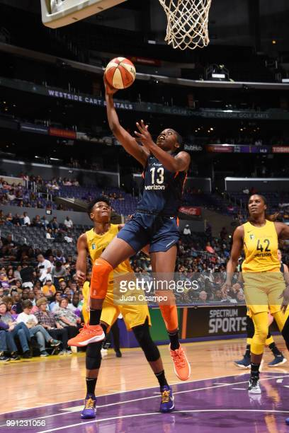 Chiney Ogwumike of the Connecticut Sun goes to the basket against the Los Angeles Sparks on July 3 2018 at STAPLES Center in Los Angeles California...
