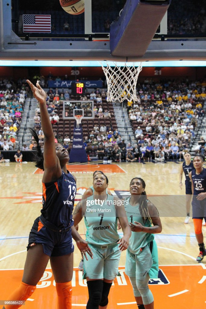Chiney Ogwumike #13 of the Connecticut Sun goes to the basket against the New York Liberty on July 11, 2018 at the Mohegan Sun Arena in Uncasville, Connecticut.