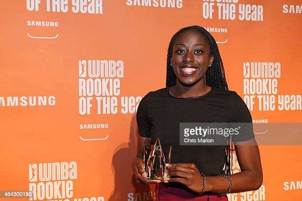Chiney Ogwumike of the Connecticut Sun poses with the 2014 WNBA Rookie Of The Year Award at a press conference on August 28 2014 at the Mohegan Sun...