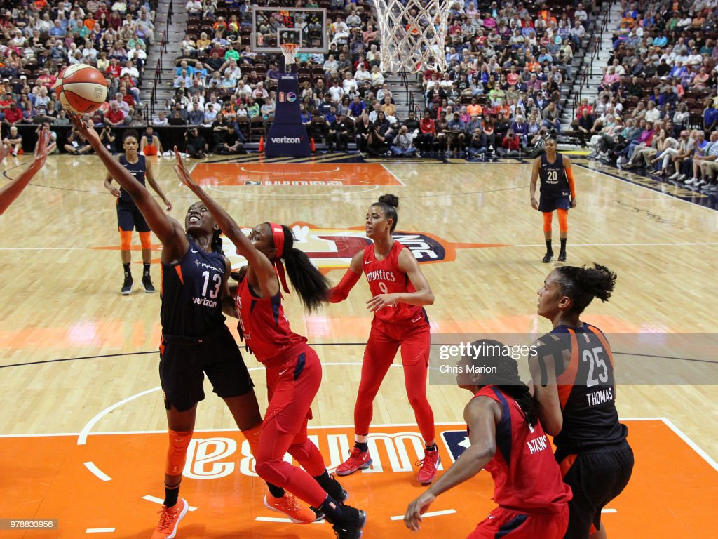 Chiney Ogwumike #13 of the Connecticut Sun reaches for control of the ball during a WNBA game on June 13, 2018 at the Mohegan Sun Arena in Uncasville, Connecticut.