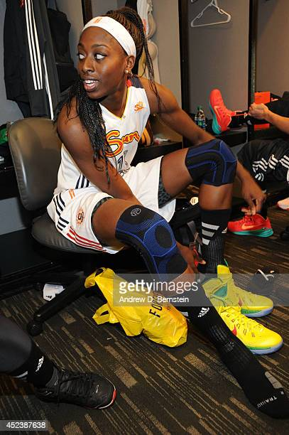 Chiney Ogwumike of the Eastern Conference AllStars puts on her sneakers in the locker room before the 2014 Boost Mobile WNBA AllStar Game on July 19...