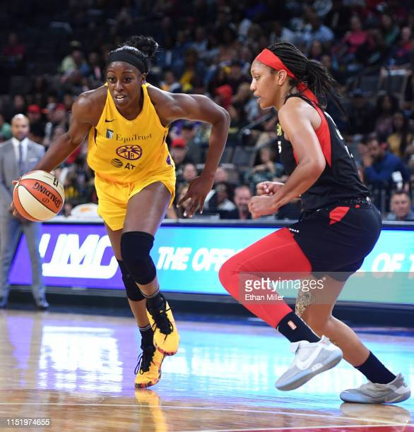 Chiney Ogwumike of the Los Angeles Sparks drives against A'ja Wilson of the Las Vegas Aces during their game at the Mandalay Bay Events Center on May...
