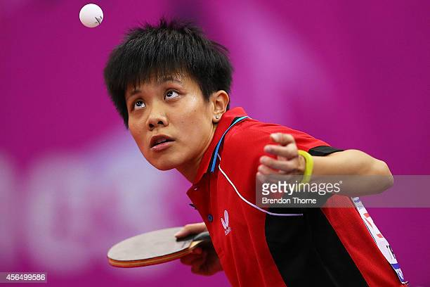 Ching Cheng of Chinese Taipei serves in her Round of 16 Elimination Match against Yang Haeun of South Korea during day thirteen of the 2014 Asian...