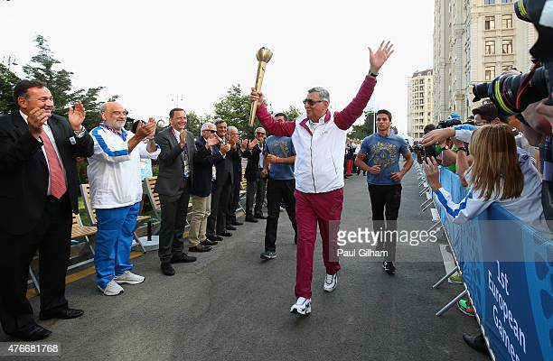 Chingiz Huseynzade Vice President of the Olympic Committee of Azerbaijan carries the torch into The Athletes Viillage during the arrival of the Torch...
