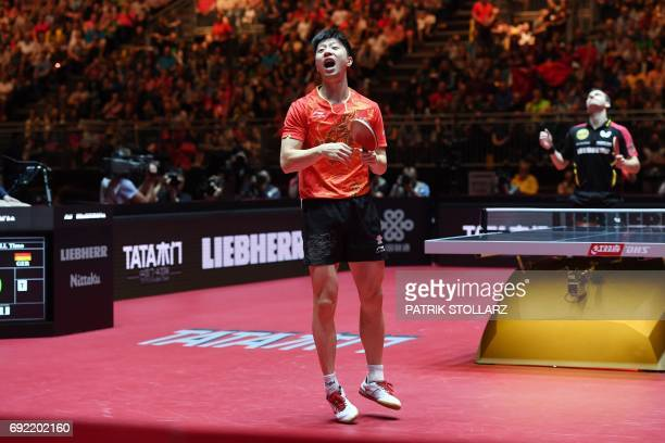 Chinise Ma Long reacts after his plays against German Timo Boll during the quarterfinal match during the WTTC World Table Tennis Championships in...