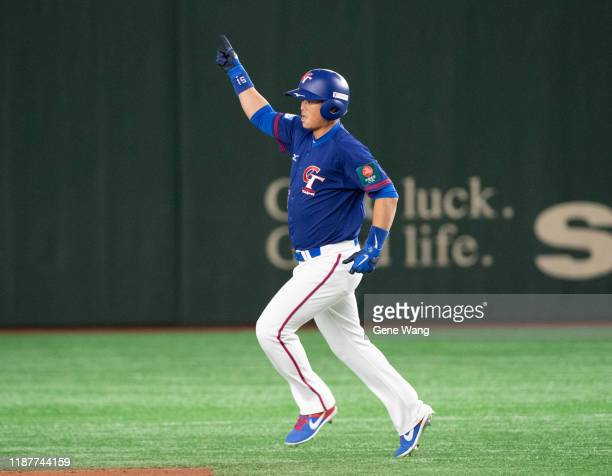 ChinLung Hu of Chinese Taipei hit a single homrun during the WBSC Premier 12 Super Round game between USA and Chinese Taipei at the Tokyo Dome on...
