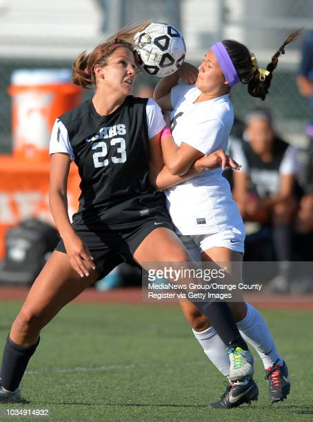 Chino Hills' Alyssa Carthan left and Westview's Cassie Taniguchi battle for a ball in the 2014 CIF SoCal Regional Soccer Championships at Warren High...