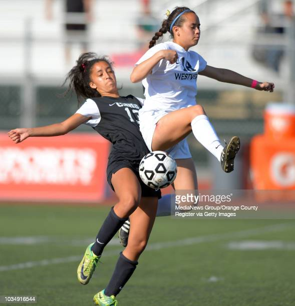 Chino Hills' Brielle Bourgeois, left, and Westview's Angel Meriwether collide in the 2014 CIF SoCal Regional Soccer Championships at Warren High in...