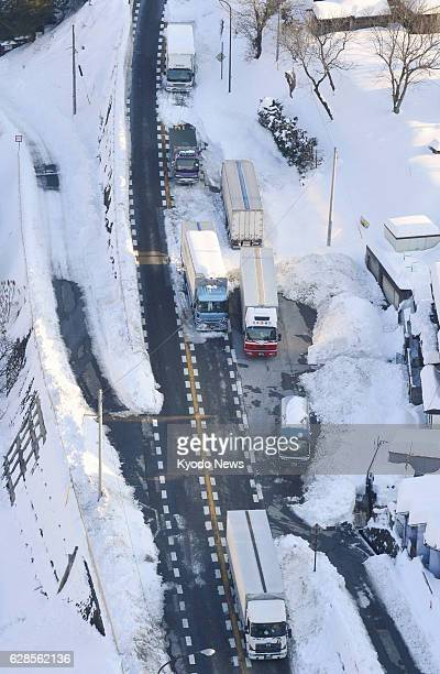 Chino Japan Photo taken from a Kyodo News helicopter on Feb 17 shows trucks stranded due to heavy snow on a national road in the city of Chino Nagano...
