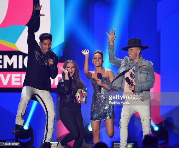 Chino Miranda Joy Uecke Leslie Grace and Jesse Uecke present an award during Univision's 'Premios Juventud' 2017 Celebrates The Hottest Musical...