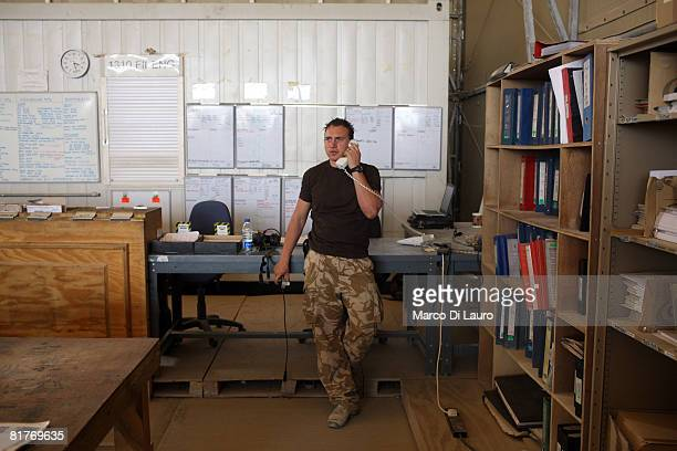 Chinook 27th Squadron Royal Air Force engineer part of the Joint Helicopter Force answers the phone on June 26 2008 at his base at the Kandahar Air...