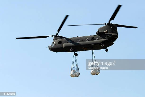 A CH-47 Chinook carrying sandbags.
