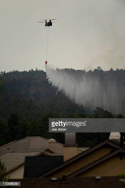A CH47 Chinook drops water near the Flying Horse sub station at the Black Forest Fire area Colorado Springs Colorado June 14 2013 Denver Colorado...