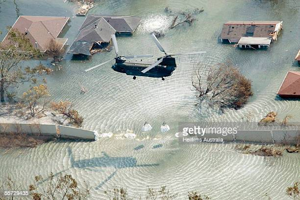 Chinook helicopter drops sand bags to plug a levee break on the east side of the London Avenue Canal September 11 2005 in the Gentilly neighborhood...