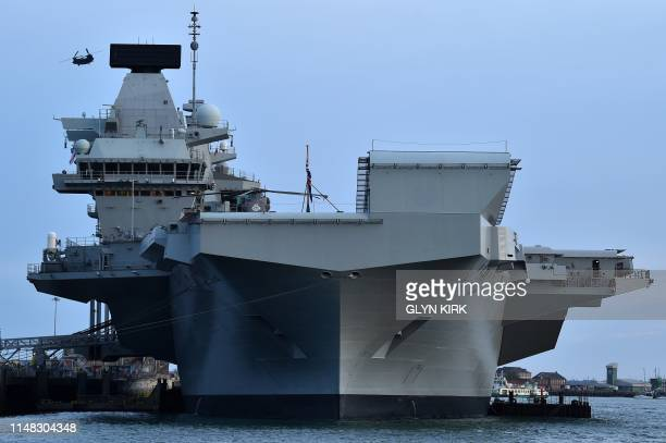 A Chinook helicopter flies over the HMS Queen Elizabeth aircraft carrier following an event to commemorate the 75th anniversary of the DDay landings...