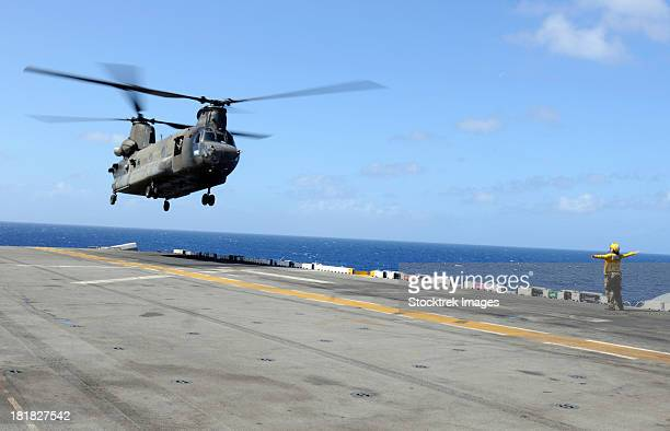 A CH-47 Chinook helicopter landing aboard USS Wasp.