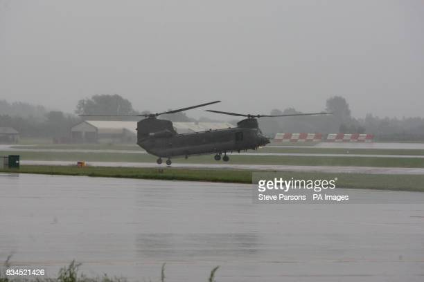 Chinook helicopter lands at the Launch of the Royal International Air Tattoo at RAF Fairford Gloustershire