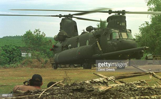 Chinook helicopter lifts off after delivering dozens of US Special Forces soldiers and their equipment to the 103rd Brigade camp February 17 2002 on...